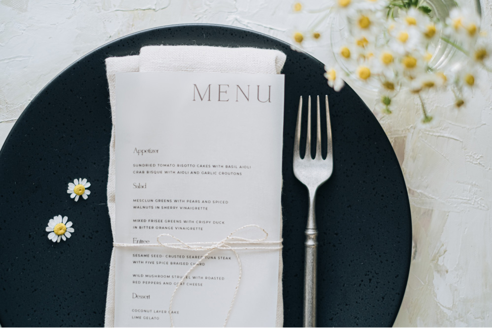 vellum menu design with daisy flowers table styling
