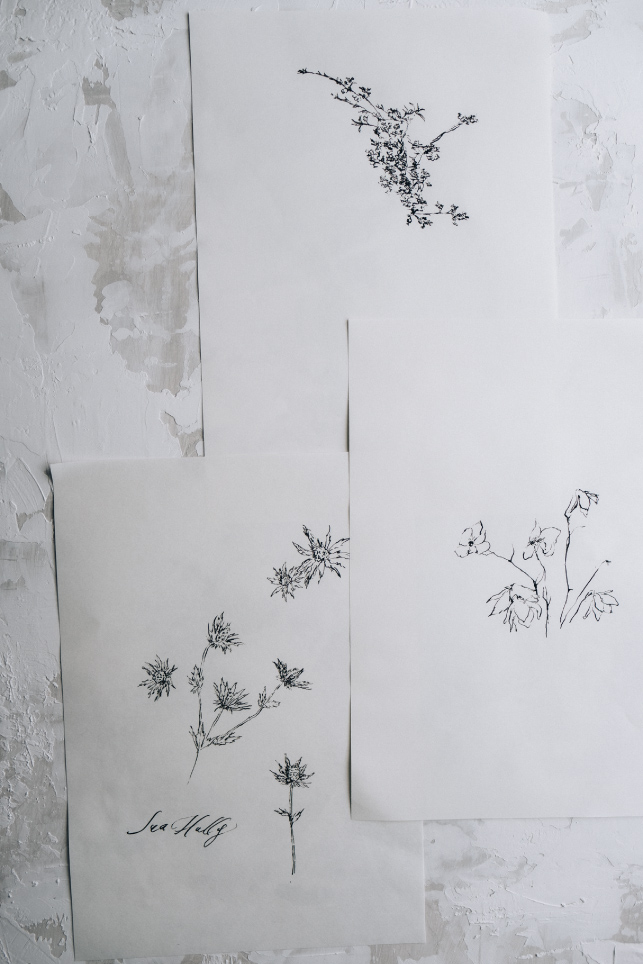 floral ink sketches on paper with a styling board