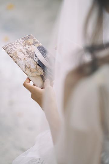 a bride holding a wedding invitation