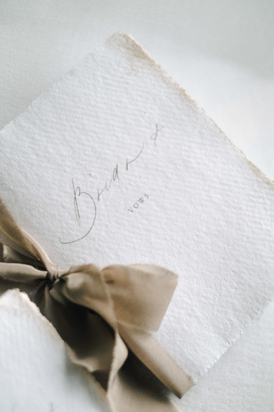 vow books with neutral beige silk ribbon